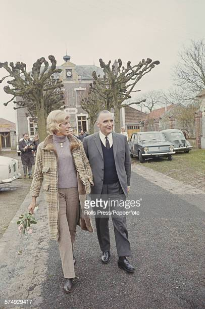 French politician and Prime Minister of France Georges Pompidou pictured with his wife Claude Pompidou as they make their way to vote in the French...