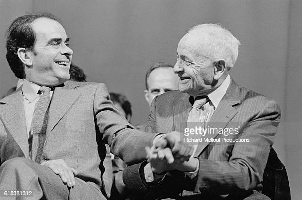 French politician and Secretary General of the Parti Communiste Francais Georges Marchais greets French writer Louis Aragon at a PCF meeting at the...