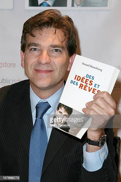 French politician Arnaud Montebourg dedicates his new book 'Des idees et des reves' at Drugstore Publicis on January 5 2011 in Paris France