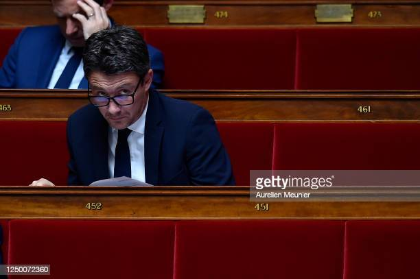 French Politician Benjamin Griveaux reacts as ministers answer deputies during the weekly session of questions to the government at Assemblee...