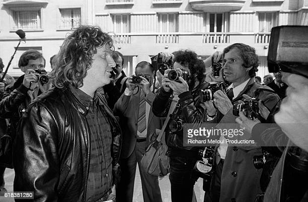 French politician Daniel Cohn-Bendit talks to photographers as he arrives at a Paris television studio. Cohn-Bendit was invited to take part in a...