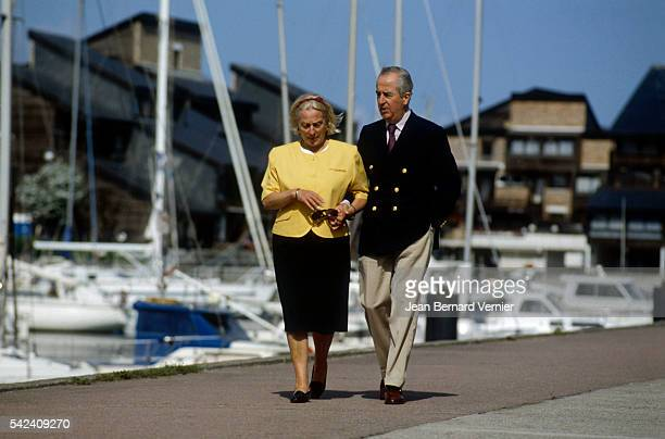 French politician Edouard Balladur walks with his wife MarieJosephe near their home in DeauvillelesBains France Balladur would become prime minister...