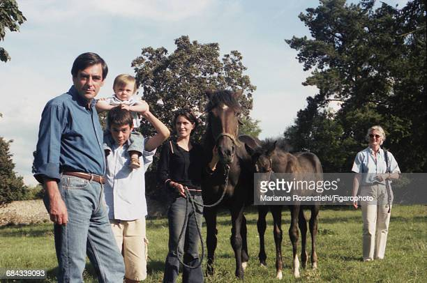 French politician François Fillon with his family, 1st September 2002. Left to right: François Fillon, his sons Edouard and Arnaud (on his brother's shoulders), his daughter Marie and his wife Penelope Clarke. Fillon is Minister of Social Affairs, Labour and Solidarity in the governnment of Jacques Chirac.