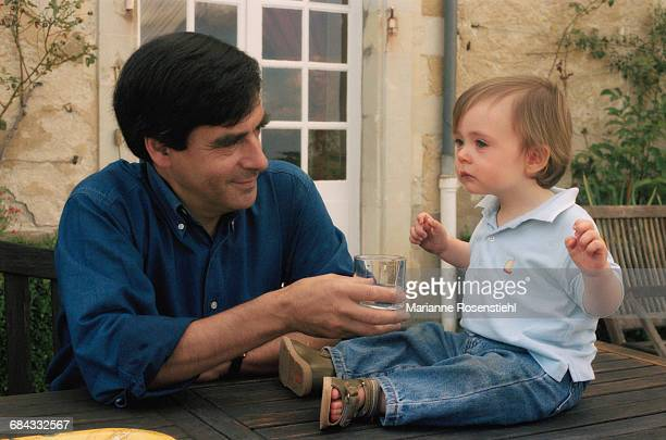 French politician François Fillon with his son Arnaud, 1st September 2002. Fillon is Minister of Social Affairs, Labour and Solidarity in the...