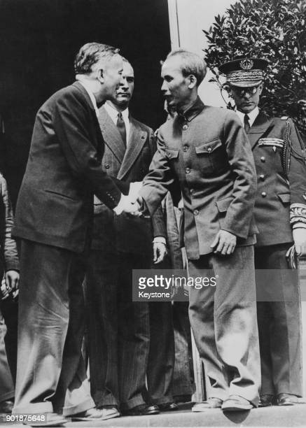 French politician Georges Bidault shakes hands with Ho Chi Minh President of the Democratic Republic of Vietnam in Paris France 4th July 1946 Charles...
