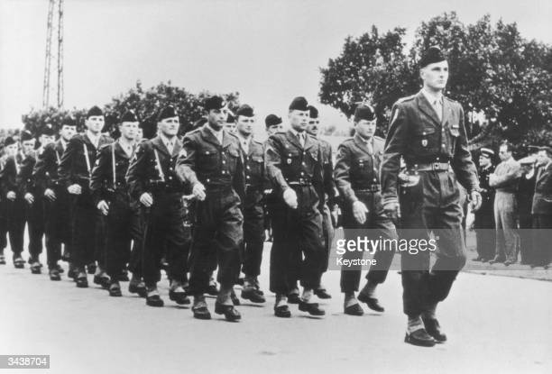 French politician Jacques Chirac heads a parade of the French army's 6th Regiment de Chasseurs d'Afrique during his period of military service