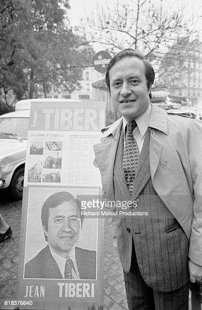 French politician Jean Tiberi stands next to one of his election campaign signs Tiberi ran against 15 other candidates for the office of Deputy Mayor...