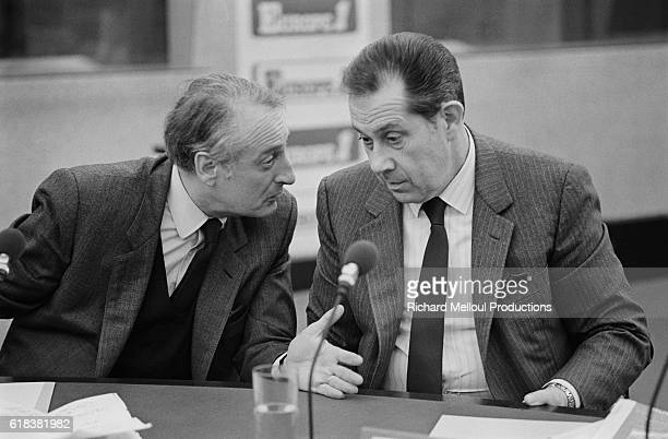 French politician JeanFrancois Deniau leans over to speak to politician Charles Pasqua during a political debate at Europe 1 radio station in Paris