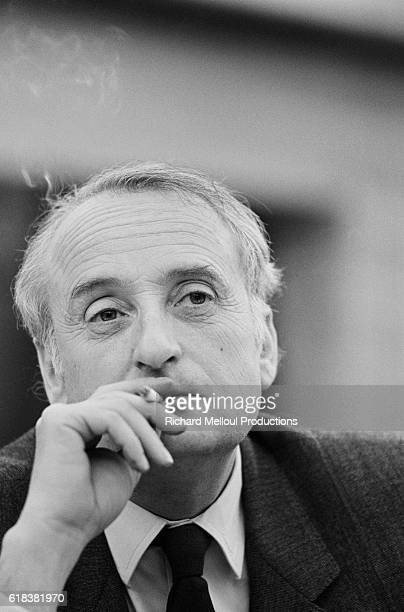 French politician JeanFrancois Deniau smokes a cigarette during a political debate with politician Charles Pasqua at Europe 1 radio station in Paris