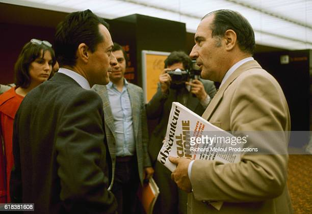 French politician Michel Rocard speaks with French President Francois Mitterrand at an event in France The socialist leader Mitterrand was elected...