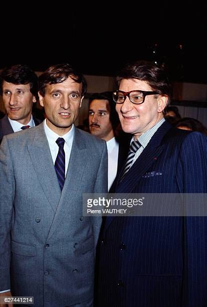 French politicians attend the Yves Saint Laurent autumnwinter 19861987 fashion show in Paris during which the designer presented his readytowear...