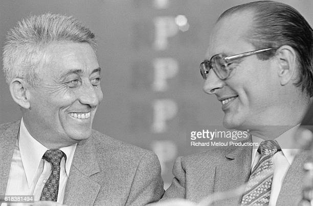 French politicians Bernard Pons and Jacques Chirac share a laugh. Pons and Chirac were attending a Rassemblement pour la Republique (RPR) political party meeting in Strasbourg.