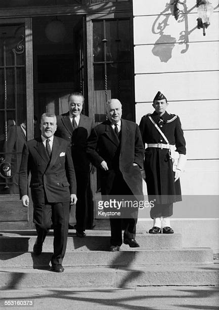 French politicians Robert Buron Prince Jean de Broglie and Secretary of State for Algerian Affairs Louis Joxe leaving the Hotel du Parc during...
