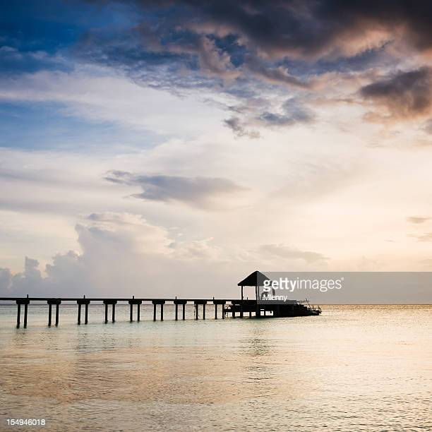 french polynesia sunset at jetty fakarava - mlenny stock pictures, royalty-free photos & images