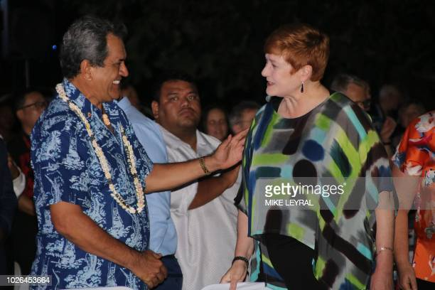 French Polynesia's President Edouard Fritch greets Australia's Foreign Minister Marise Payne during the opening ceremony of the Pacific Islands Forum...