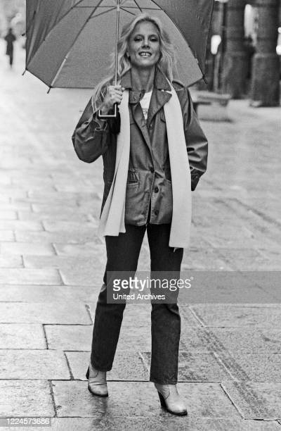 French pop and chanson singer Sylvie Vartan on a rainy day at Hamburg, Germany circa 1984.