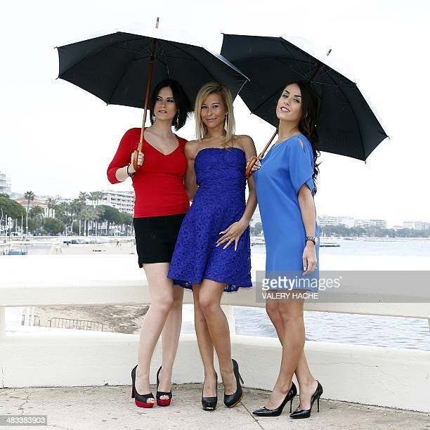 French pornography actresses Claire Castel Lola Reve and Jade Laroche pose for a photograph during a photocall for the Dorcel 35th Anniversary show...