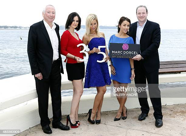 French pornography producers and directors Marc Dorcel and Gregory Dorcel pose alongside French porn actresses Claire Castel Lola Reve and Jade...