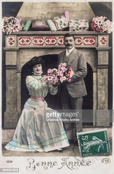 French postcard dated circa 1900 showing a young romantic couple sharing flowers