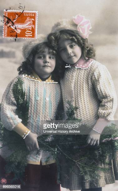 French postcard dated circa 1900 showing two well dressed young girls