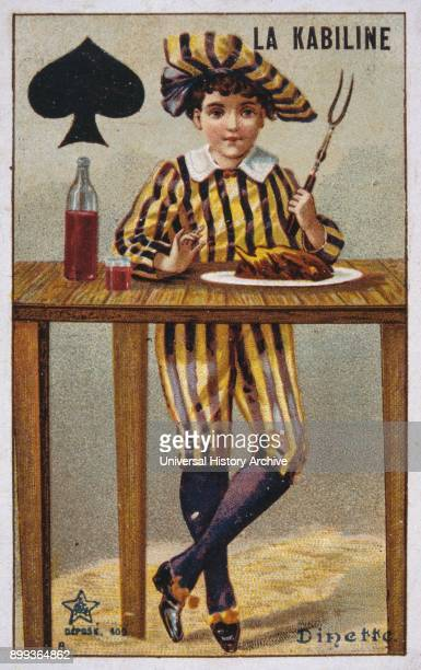 French postcard of 1900 depicting a boy in traditional costume standing at a table ready to eat