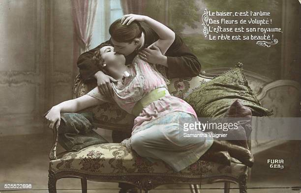 French postcard showing couple kissing on sofa
