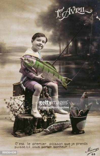 French postcard with image of a boy holding a fish