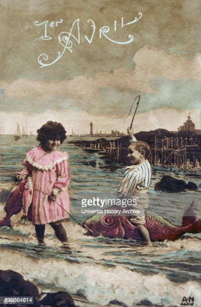 French postcard with image of a girl and boy capturing a sea fish