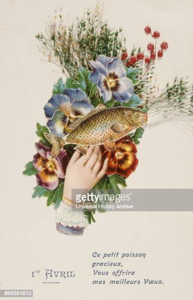 French postcard with image of a hand fish and flowers