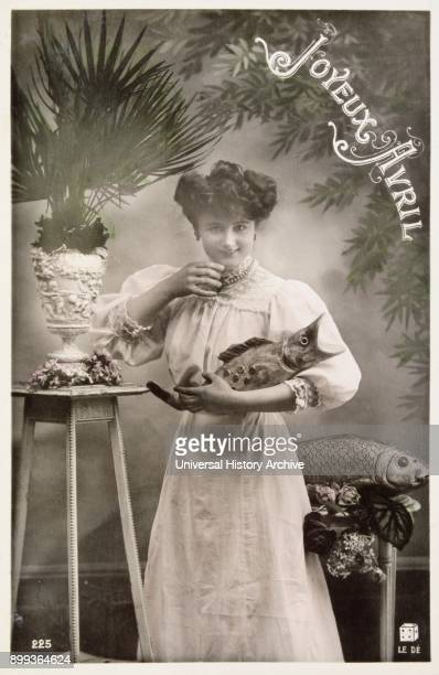 French postcard with image of a woman holding a cat