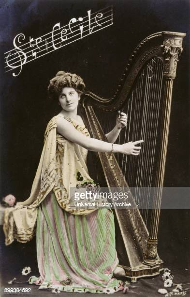 French postcard with image of a woman playing a harp 1900