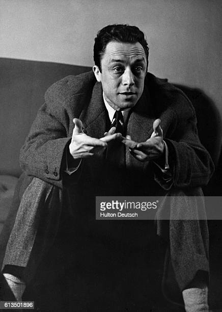 French postexistentialist writer Albert Camus gestures in discussion He was well known for his cool careful analysis of the individual and the truth...
