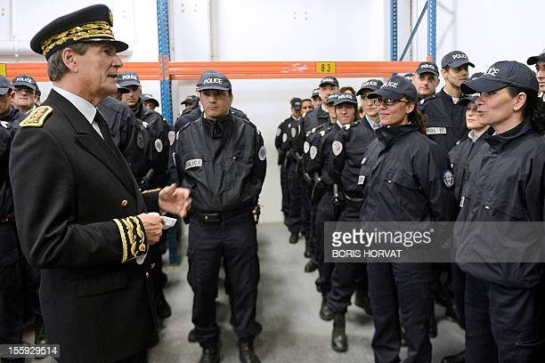 French prefect of the BouchesduRhône region JeanPaul Bonnetain welcomes new policemen on November 9 2012 in Marseille southern France French Prime...