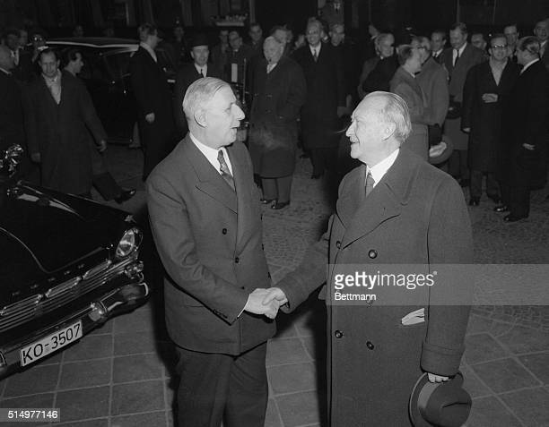 French Premier Charles de Gaulle shakes hands with West German Chancellor Konrad Adenauer during their one-day meeting in Bad Kreuznach, West Germany.