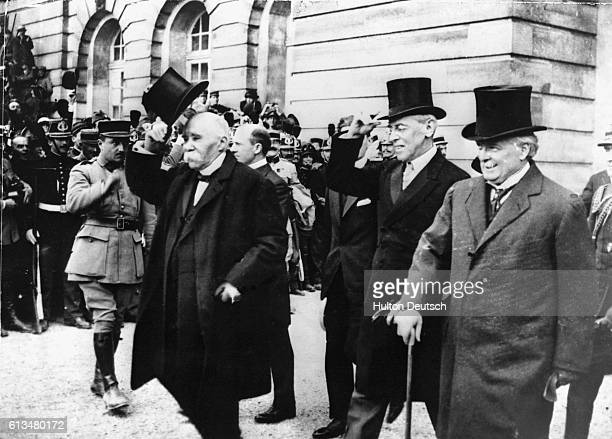 French Premier Georges Clemenceau American President Woodrow Wilson and British Prime Minister Lloyd George after signing the treaty of Versailles at...