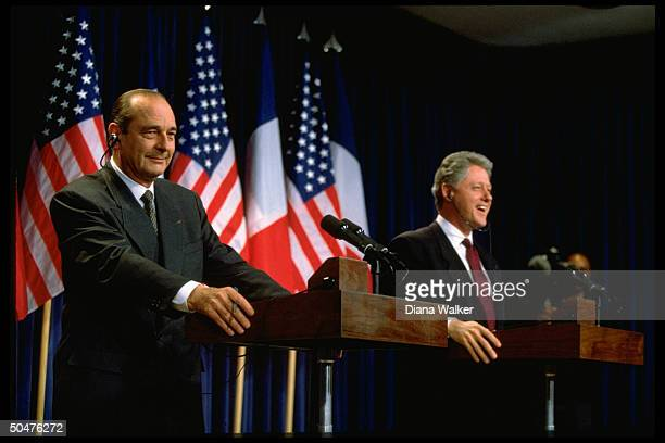 French Pres Jacques Chirac Pres Bill Clinton holding joint press conf after Oval Office mtg at WH