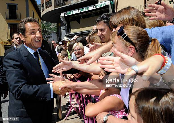 French President and Andorra coprince Nicolas Sarkozy shakes hands with the public in the streets of Andorra la Vella during a official visit on July...