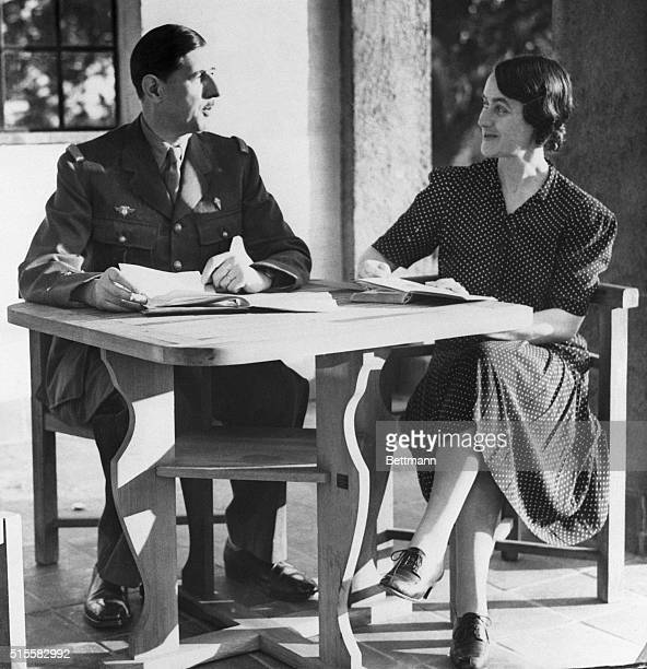 French President Charles De Gaulle and his wife Yvonne relax at their country home | Location Hertforshire England UK