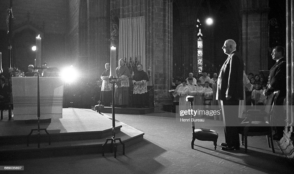 French President Charles de Gaulle (1890 - 1970, right ) attends a church service in Quimper during a visit to Brittany, France, February 1969.