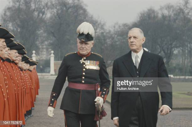 French President Charles de Gaulle inspects a line of Chelsea Pensioners during a State Visit to London, April 1960.