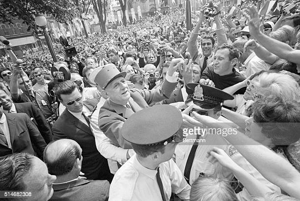 French President Charles De Gaulle is met by an enthusiastic crowd outside the City Hall in Quebec City