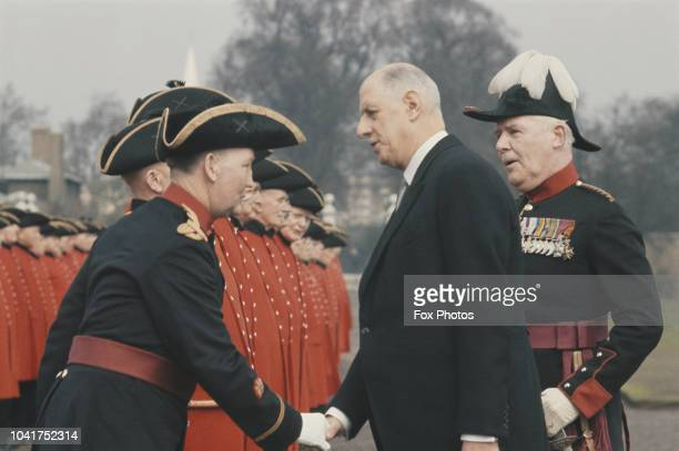 French President Charles de Gaulle meets a line of Chelsea Pensioners during a State Visit to London, April 1960.