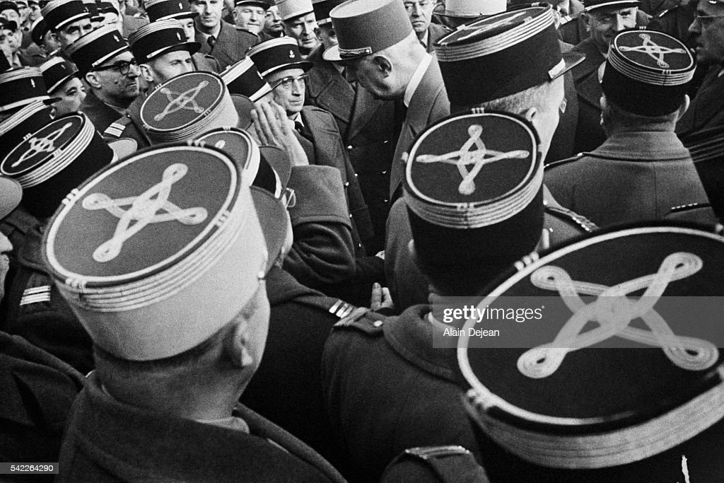French President Charles de Gaulle meets soldiers on Armistice Day in Strasbourg.