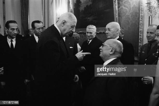 French President Charles de Gaulle speaking with Communist leader Jacques Duclos at the Elysee Palace