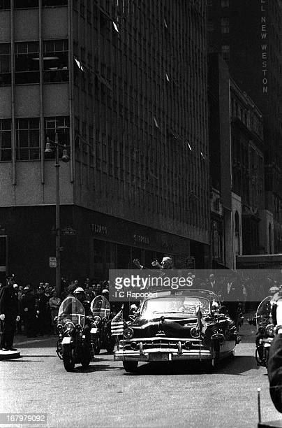 French President Charles de Gaulle waves to the crowd after receiving a tickertape parade on April 26 1960 in New York City New York
