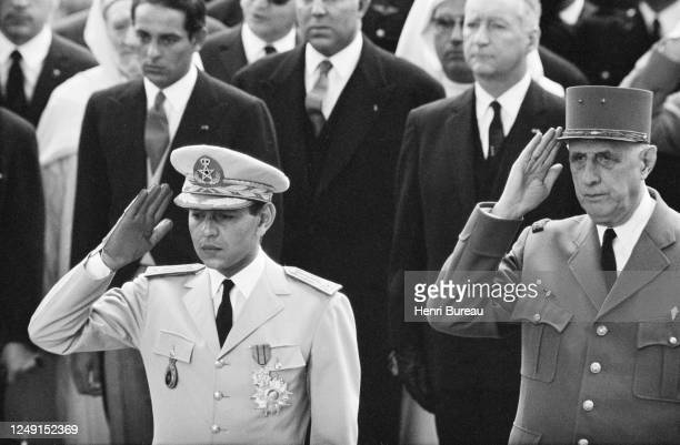 French President Charles De Gaulle with the King of Morocco, Hassan II in front of the Arc de Triomphe.