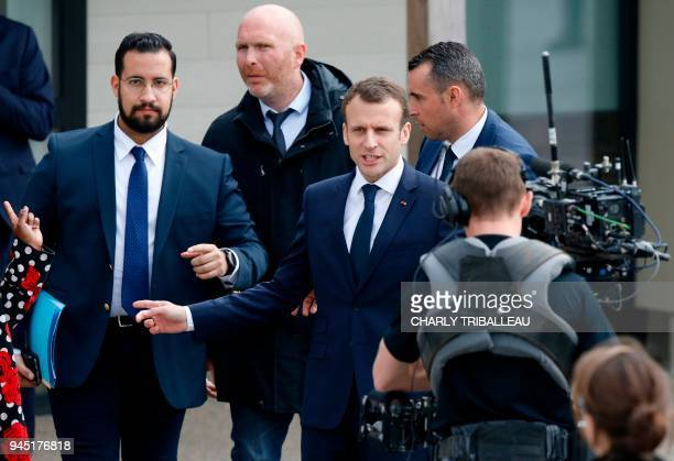 French President Emmanual Macron next to Elysee Chief Security Officer Alexandre Benalla arrives at a primary school in Berd'huis northwestern France...