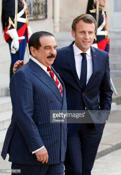 French President Emmanuel Macron accompanies Bahraini King Hamad bin Isa bin Salman Al Khalifa after their meeting at the Elysee Presidential Palace...