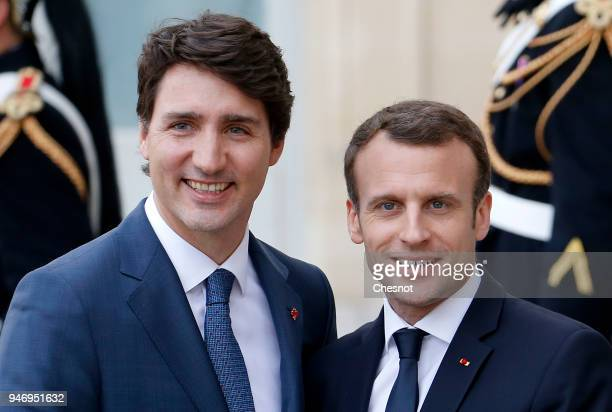 French president Emmanuel Macron accompanies Canadian Prime Minister Justin Trudeau after their meeting at the Elysee Palace on April 16 2018 in...
