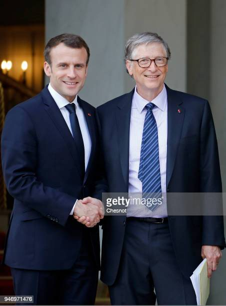 French president Emmanuel Macron accompanies Cochairman and cofounder of the The Bill and Melinda Gates Foundation Bill Gates after their meeting at...